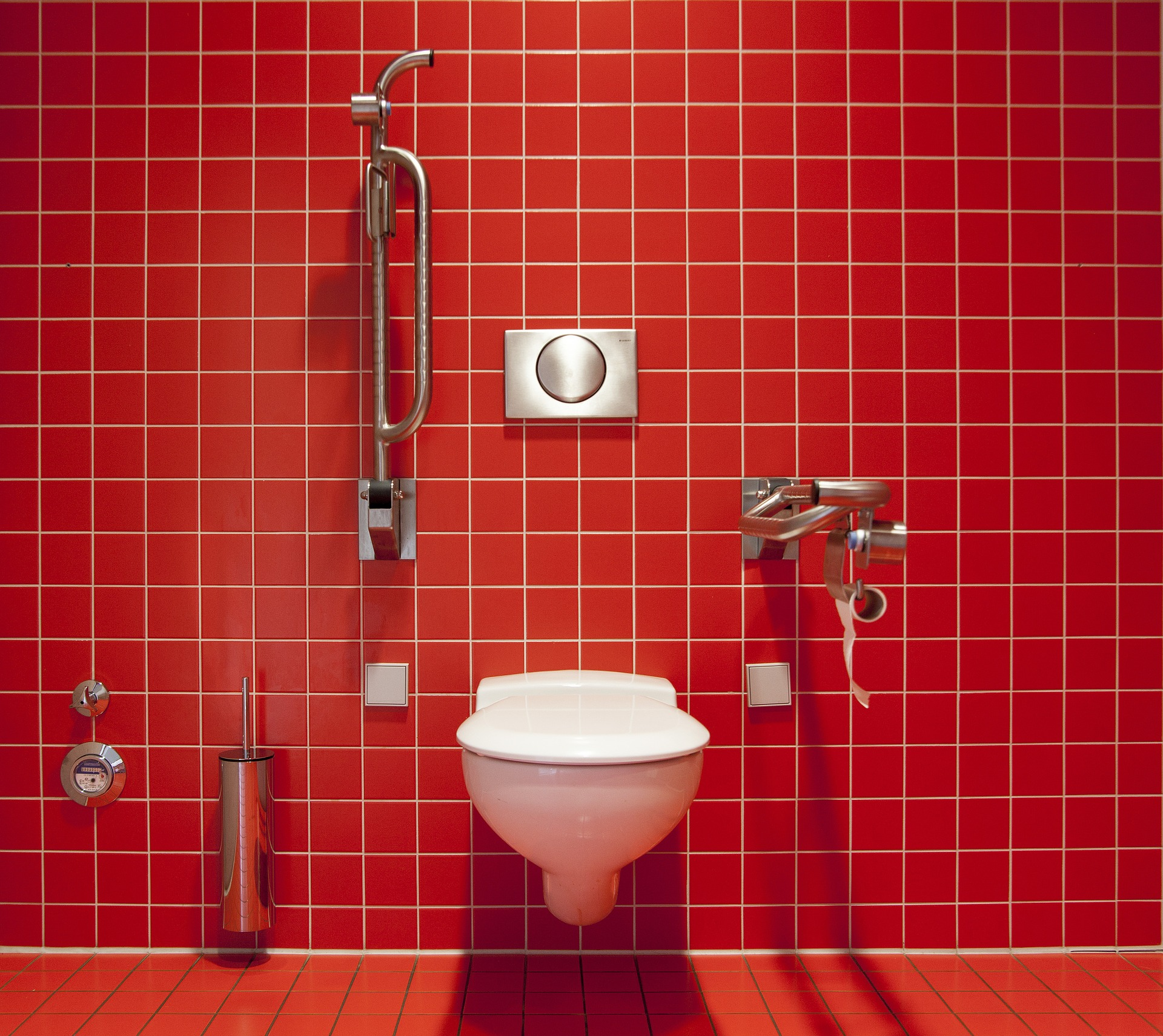 Red tile bathroom with toilet